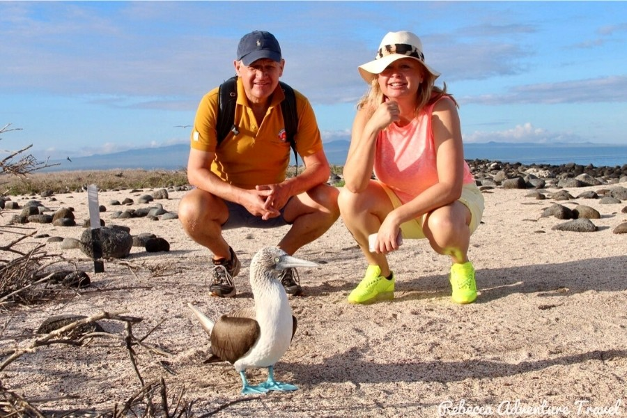 Couple and Galapagos blue Footed Boobie - About Rebecca Adventure Travel